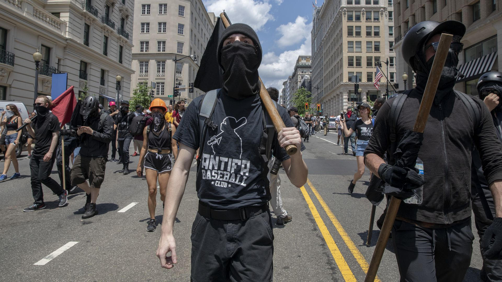 Antifa marching with clubs