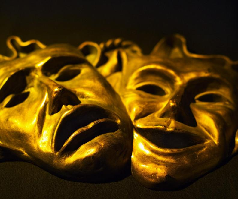 Classical comedy-tragedy face masks used in the Greek and Roman theaters